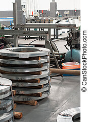 Industrial works - Rolls of hoop iron ready to be shaped
