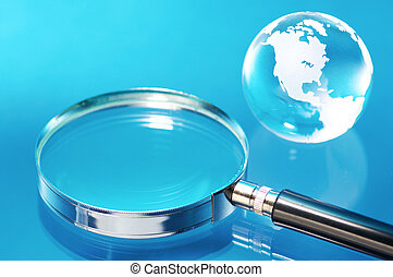 Glass globe and magnifying glass.