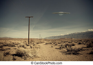 UFO over desert road - Low flying UFO spaceship hovering...