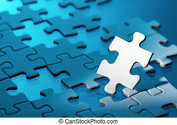 Closeup of unfinished jigsaw puzzle - Concept image of...