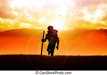 Sunrise Hiking - Silhouette of a man figure trekking on the...