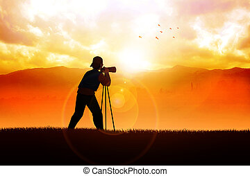 Photographer - Silhouette of a photographer aiming his...