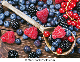 Fresh berries and old wooden spoon - Assorted Fresh berries...