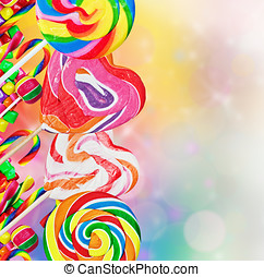 Colorful lollipops and sweets on a colored background