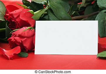 roses and white card with a place for a congratulatory text