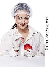 GMO experiment - smiling chemist woman injected some liquid...