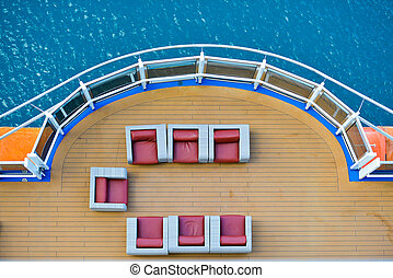 Cruise ship deck with blue water in background