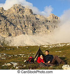 People camping in the mountains with spectacular landscape