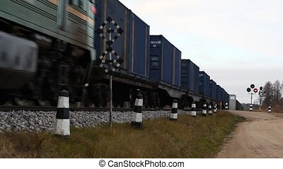 Rail crossing by train and wagons