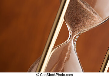 hourglass - time concept ,selective focus on center of sand...