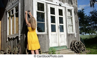 woman hammer horse shoe - Woman in yellow dress hammering...