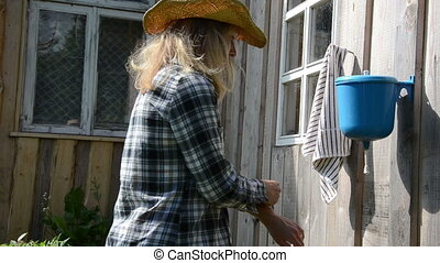 gardener woman wash hand - gardener girl woman wash hands...