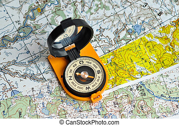 Compass and map. - Outdoor compass in orange body with black...