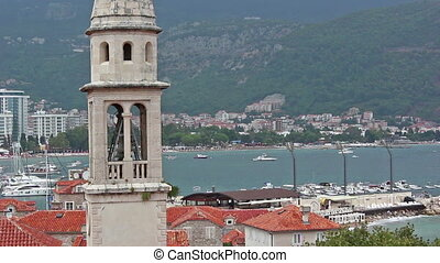 Bell tower, cathedral - View of the town of Budva, the bell...