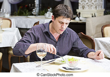 young man eating in a restaurant