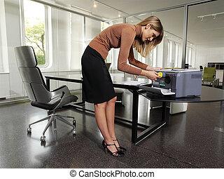 woman with copy machine tyu