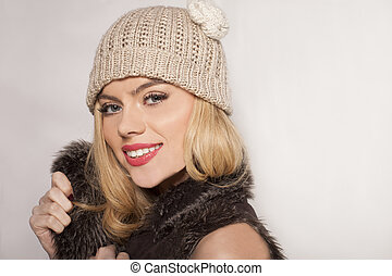 Attractive blond in a winter jacket and beanie - Attractive...