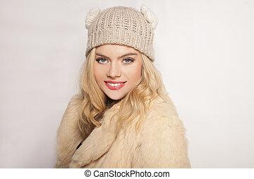 Beautiful blond girl in winter fashion