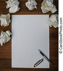 file of luxury pen ,white paper and crumpled paper on...