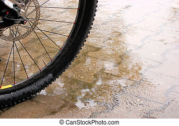 Mountainbiking in the wet rain - A mountainbike tire in a...