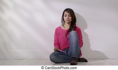 Sad Asian girl looking at pregnant