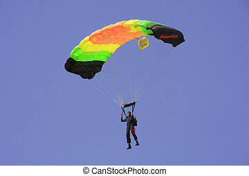 Skydiver againt blue sky