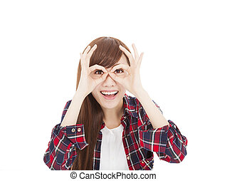 happy young woman with eyes gesture