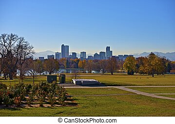Denver City Park and Downtown Denver Skyline with Mountains...