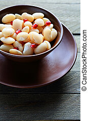 Cooked white beans with pomegranate