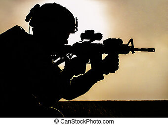 soldier - Silhouette of young soldier in military helmet...