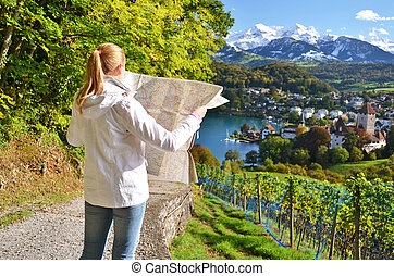 Girl looking to the map Switzerland