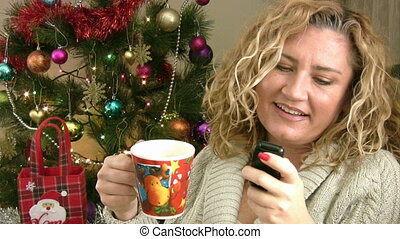Woman sending text messaging for christmas