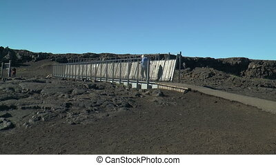 bridge between eurasian american plates - Woman walking over...