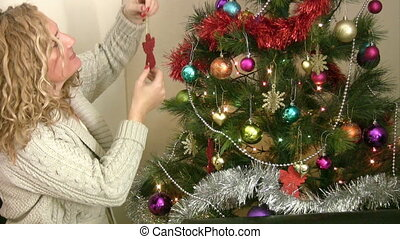 Woman decorating the christmas tree