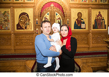 ALMATY, KAZAKHSTAN - DECEMBER 17: Christening ceremony on December 17, 2013 in Almaty, Kazakhstan. Family celebrating  baptism in Orthodox Church - Monastery of St. Matrona