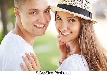 Cheerful dates - Happy girl and her boyfriend looking at...