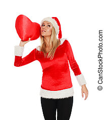 Christmas girl with big red heart in her hand, isolated on white background
