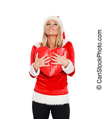 Dreaming christmas girl with big red heart in her hand, isolated on white background.