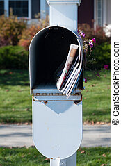 Mail box with newspaper and letters - US Mail box with...