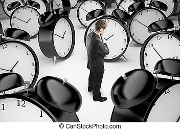 man and clocks - thoughtful businessman and alarm clocks