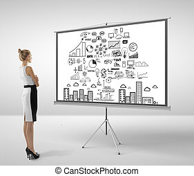 woman looking at flipchart - businesswoman looking at...