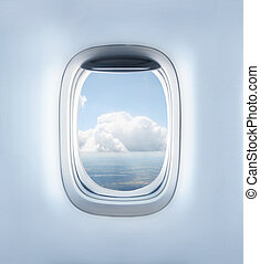 porthole - clouds in the aircraft's porthole