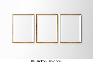 three wooden frames on white wall