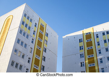 building on a bright day - Modern, new executive apartment...