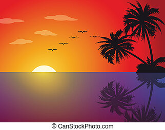 Tropical sunset on the beach with palm trees