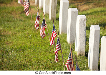 American flags near gravestones at Arlington National...