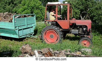 farmer tractor firewood - Farmer with hat exit tractor...