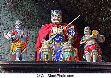 Qiyun Shan, China.Taoist statues decorating an altar carved...