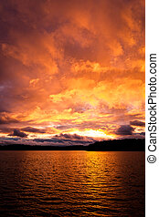 Dramatic fire red sunset over a lake