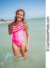 Cute girl on the beach - Beautiful happy smiling girl on...